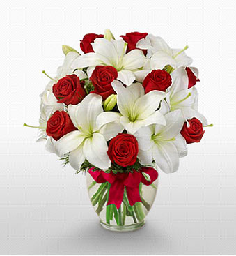 İstanbul Ümraniye hediye çiçek yolla  1 dal kazablanka 11 adet kırmızı gül vazosu