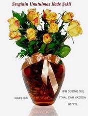 İstanbul Ümraniye internetten çiçek satışı  mika yada Cam vazoda 12 adet sari gül